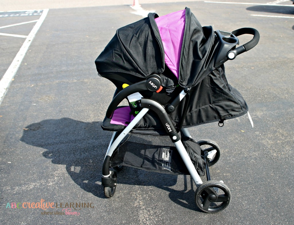 Styling in the #Urbini Emi Luxery Travel System Stroller with Lightweight Baby Car Seat and 5 Point Harness