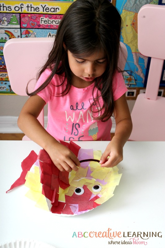 Paper Plate Fish Craft Adding eyes and mouth