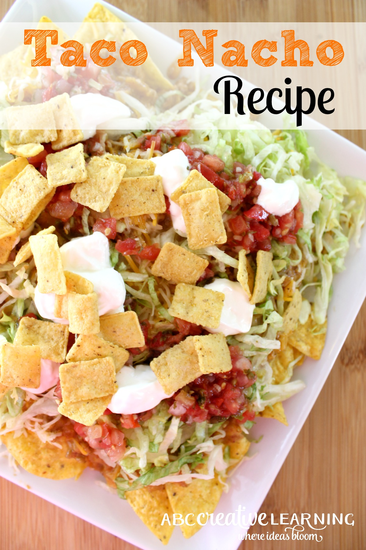 A delicious and Easy Taco Nacho Recipe perfect for get togethers! The perfect recipe for sharing! - abccreativelearning.com