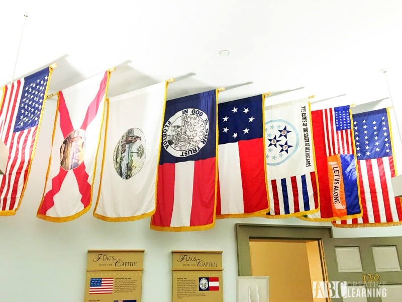 Family Travels To Florida Historic Capitol Museum flags